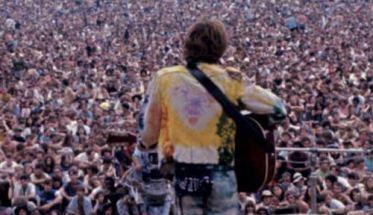 immagine di Woodstock nella copertina del libro di Luca Pollini, Woodstock non è mai finito