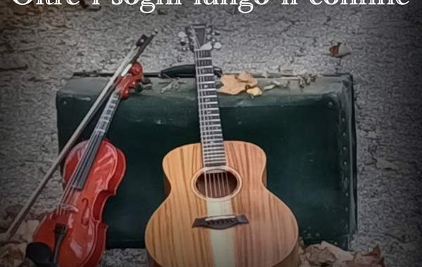chitarra, violino e valigia in copertina del disco: Oltre i sogni lungo il confine