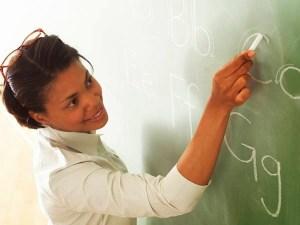 Teacher Writing Alphabet on Chalk Board 2003