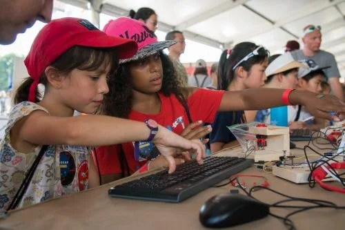 Girls use the physical computing blocks at Maker Faire New York