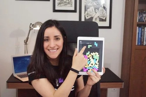 A woman showing off a game on a tablet — Estefannie Explains it All Raspberry Pi
