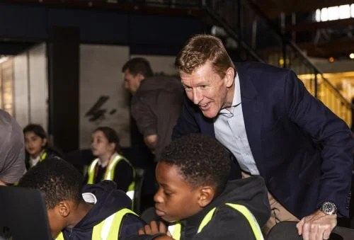 Tim Peake observes two boys writing code that will run in space as part of the European Astro Pi Challenge