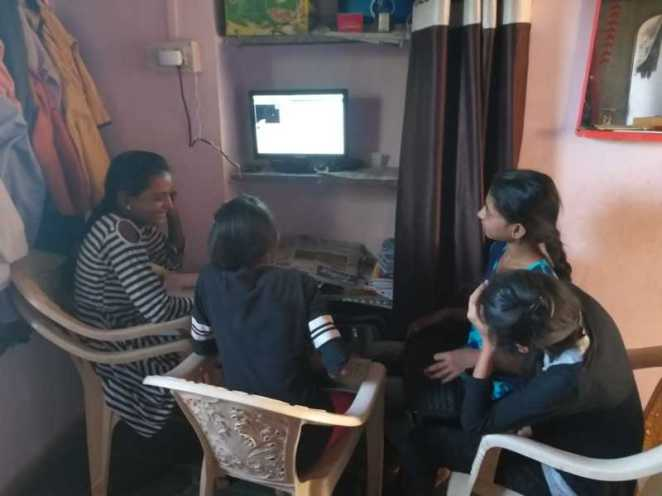 A youth volunteer demonstrates her newly-acquired coding skills at Code Club India