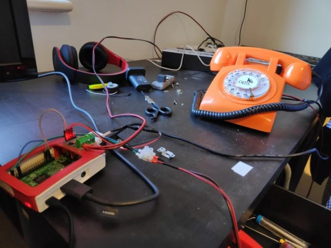 Testing a phone for use in the Rotary Dial Phone Project. Power constraints mean the phone's bell and the recording sign have to be disconnected when the Raspberry Pi that controls them boots up