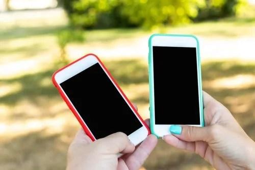 """Two smartphones, blank screen"" by Artem Beliaikin is licensed under CC0 1.0"