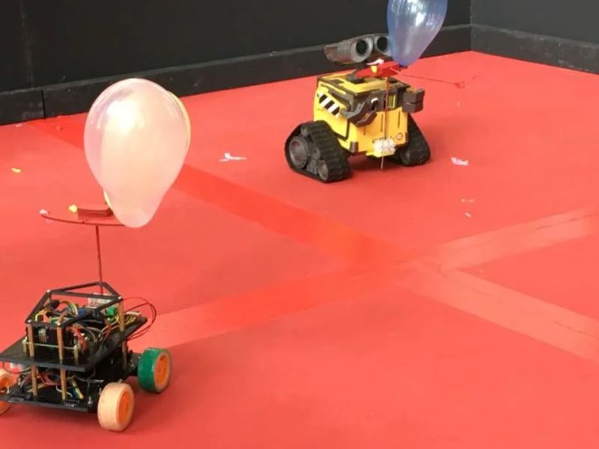 Rival robots circle each other in the Pi Noon ring at Pi Wars 2019