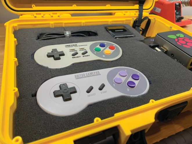 The Console Edition is essentially a Raspberry Pi with RetroPie installed connected to a display in a case with foam inserts for controllers and accessories