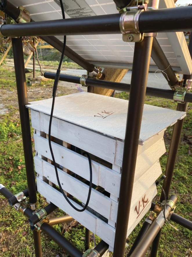 The first prototype system set out in the field. Sensors hang out of the box to obtain an