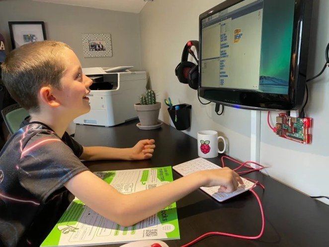 a kid doing digital making at home