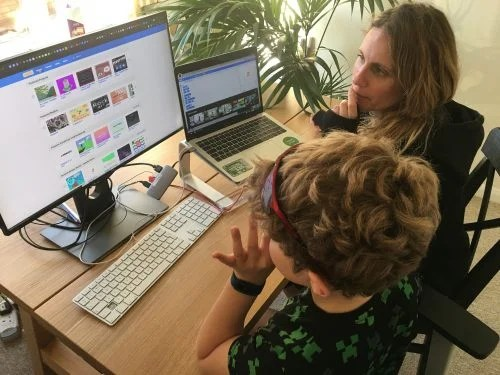 A mother and child coding at home