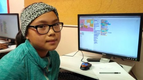 A girl with her Scratch project