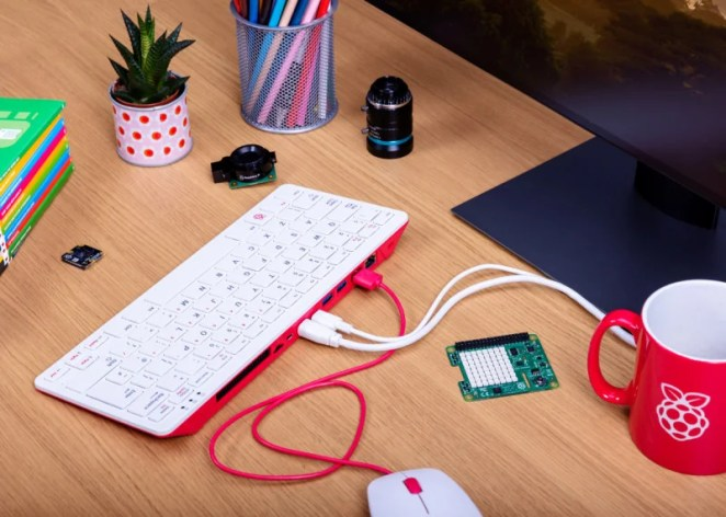 The Raspberry Pi 400 with a mouse, USB-C power, and HDMI cable attached
