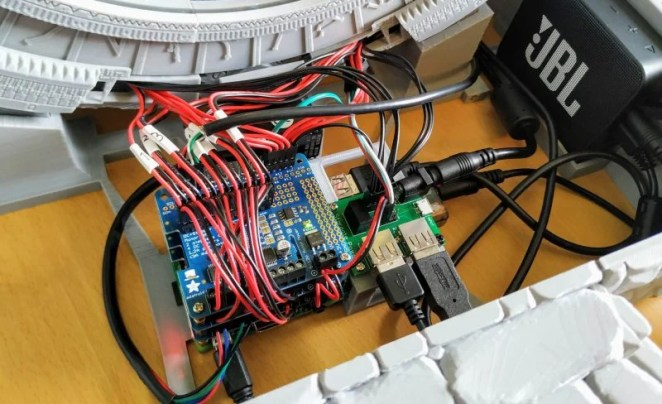 Raspberry Pi buried in the wires powering the mini stargate
