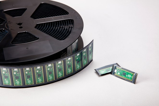 A reel of Raspberry Pi Pico microcontroller boards ready for distribution