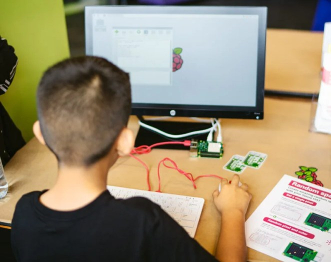 A young person using Raspberry Pi hardware and learning resources to do digital making