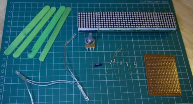 Additional components for the build include resistors, a capacitor, and perfboard