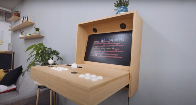 finished hidden arcade mounted on wall