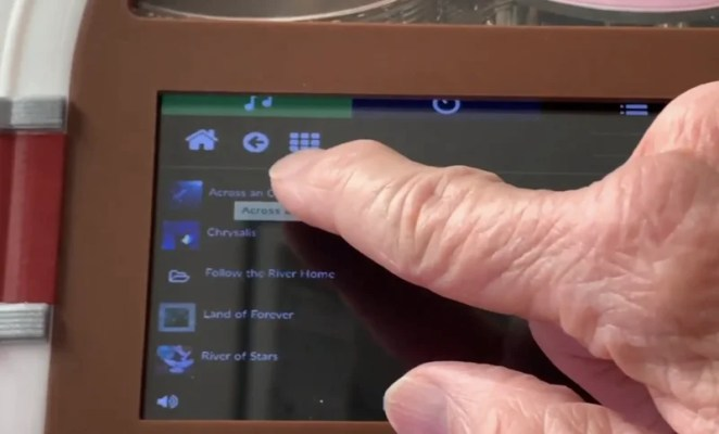 Bob selects a song on the touchscreen panel, which shows Volumio's intuitive user interface