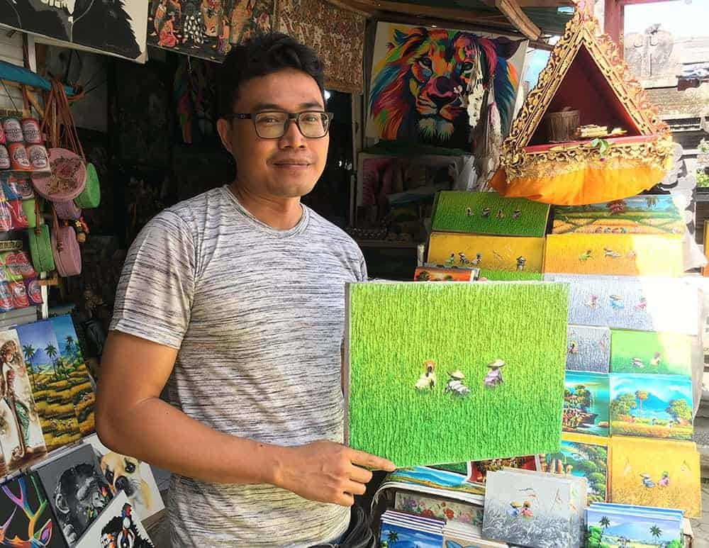 Buying art at Ubud market