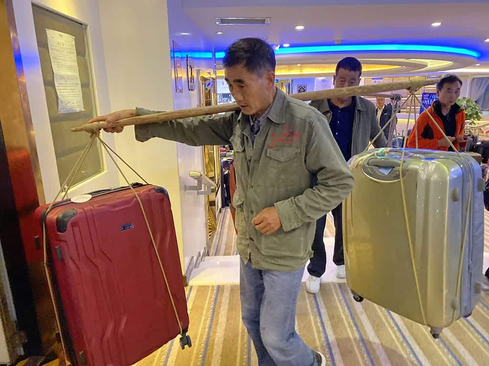 This is how the ship's porters take your luggage on and off!