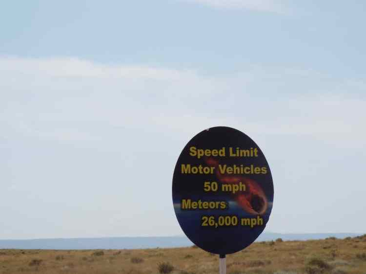 Road sign on way to  meteor city crater location