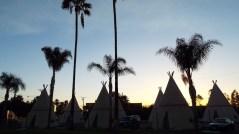 dusk falls at The wigwam Motel