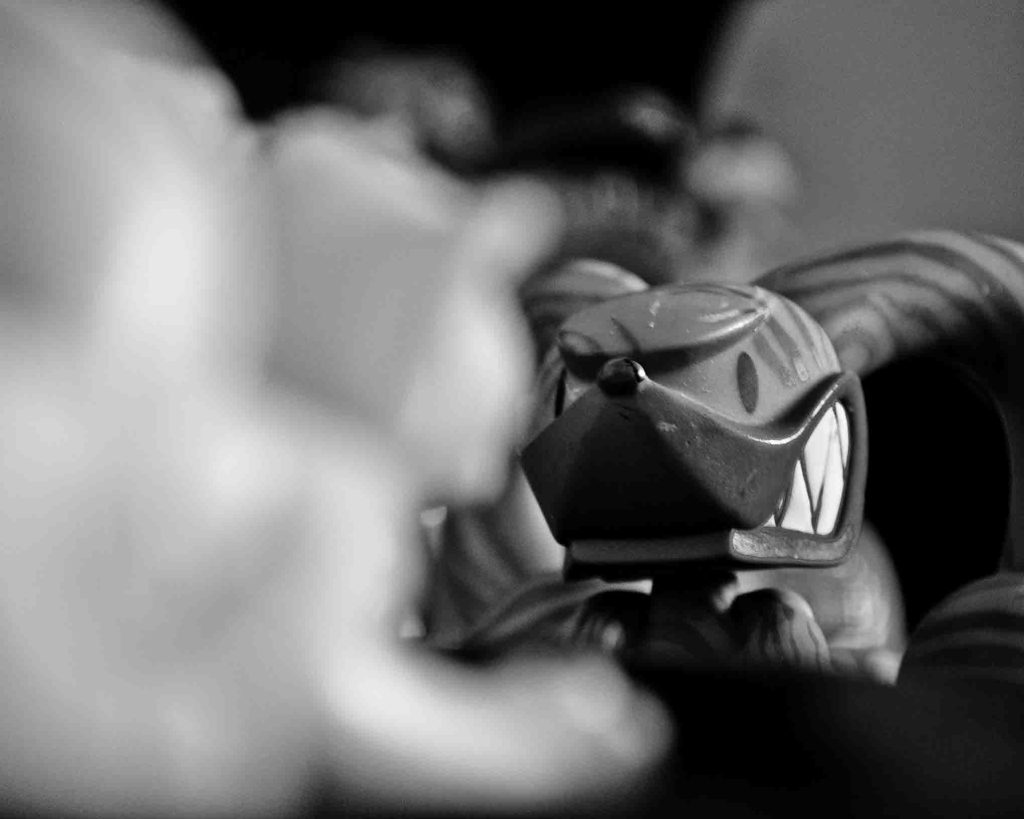 black and white of a mean looking toy