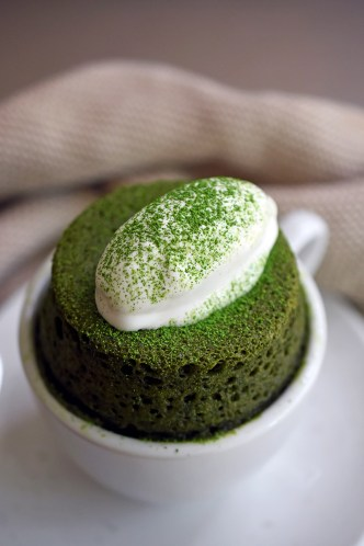 matcha cake in white mug