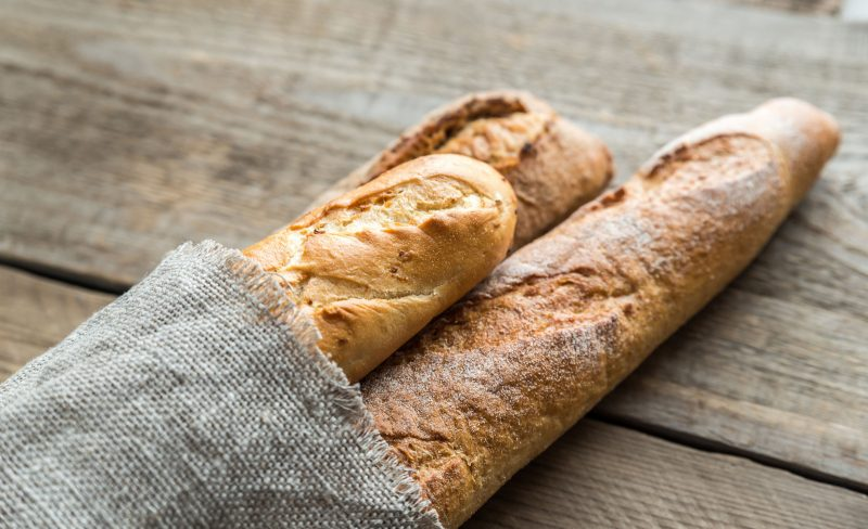 3 baguettes bread on wooden backrground