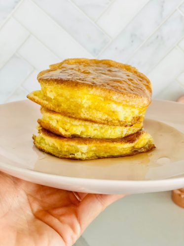 fluffy keto souffle pancake stack on a white plate