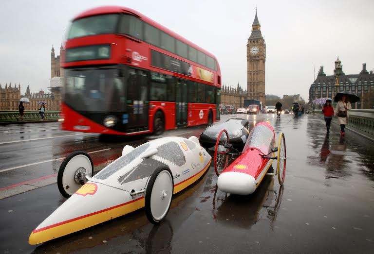 EDITORIAL USE ONLY5 futuristic hyper-efficient cars, designed by students from the UK for the Shell Eco-marathon – a competition to see how far the vehicles can travel on 1 litre of fuel, drive over Westminster Bridge in London to mark its arrival to the UK. PRESS ASSOCIATION Photo. Picture date: Wednesday November 4, 2015. This year's event is going beyond the student competition by launching 'Make the Future', a public festival to raise greater awareness of the wider energy challenge faced by the UK. The festival will be taking place at London's Queen Elizabeth Olympic Park from June 30 to July 3 2016. Photo credit should read: Matt Alexander/PA Wire