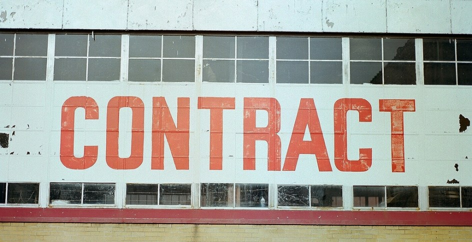 Building with the word 'contract' written on it in large, red capital letters