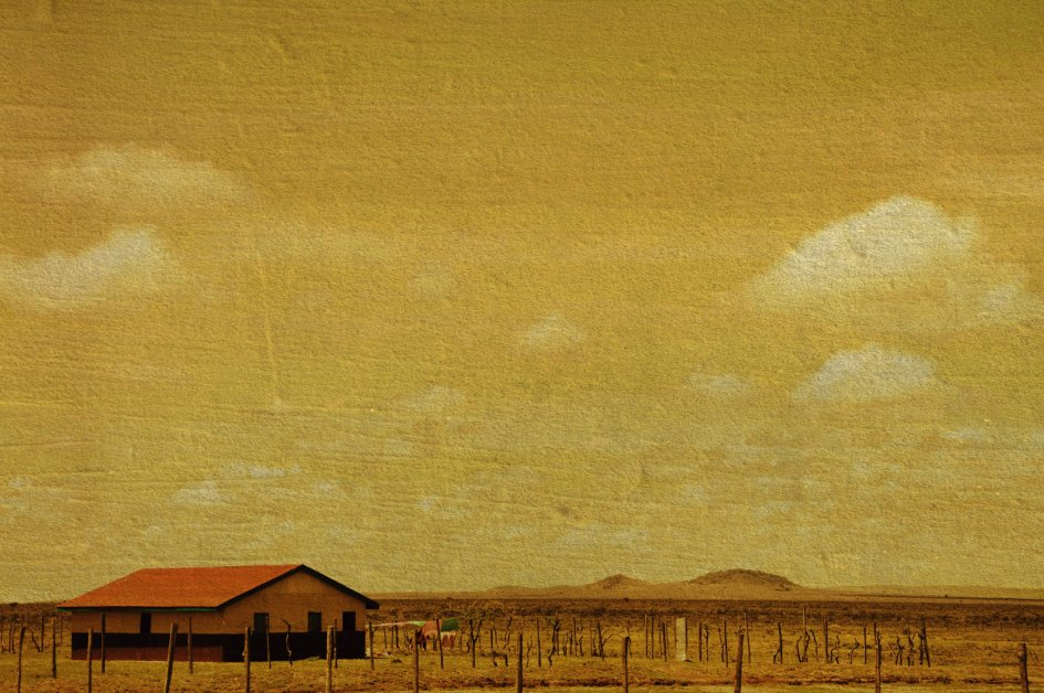 Art photograph of one lonely building in a desert landscape