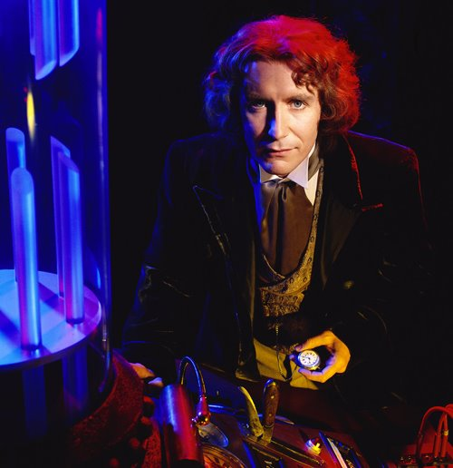 ca. 1995 --- Actor Paul McGann dressed as Dr. Who standing by a control board. --- Image by © Marc Bryan-Brown/Corbis
