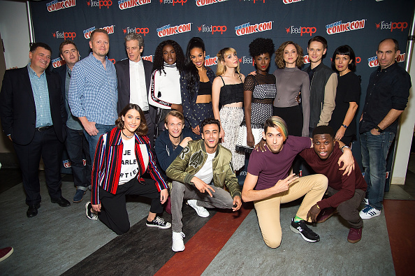 NEW YORK, NY - OCTOBER 07: (L-R Back) Steven Moffat, Brian Minchin, Patrick Ness, Peter Capaldi, Vivian Oparah, Pearl Mackie, Hannah Marks, Jade Eshete, Fiona Dourif, Samuel Barnett, Sarah Barnett, Robert Cooper (L-R Front) Sophie Hopkins, Greg Austin, Fady Elsayed, Max Landis and Mpho Koaho attend BBC America Takeover featuring Doctor Who, Class and Dirk Gently's Holistic Detective Agency press room during 2016 New York Comic Con at The Theater at Madison Square Garden on October 7, 2016 in New York City. (Photo by Michael Stewart/FilmMagic)