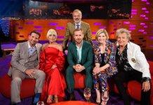 Presenter Graham Norton (standing) with (left to right) Bradley Cooper, Lady Gaga, Ryan Gosling, Jodie Whittaker and Sir Rod Stewart