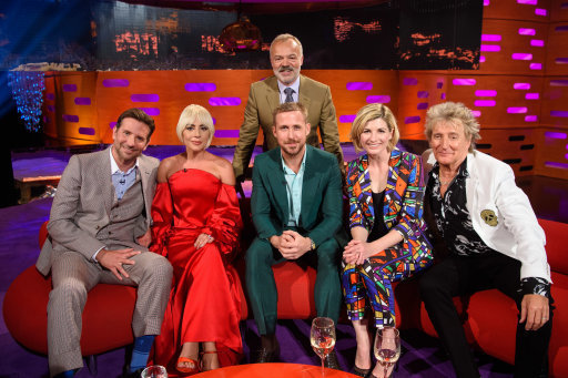 Presenter Graham Norton (standing) with (left to right) Bradley Cooper, Lady Gaga, Ryan Gosling, Jodie Whittaker and Sir Rod Stewart