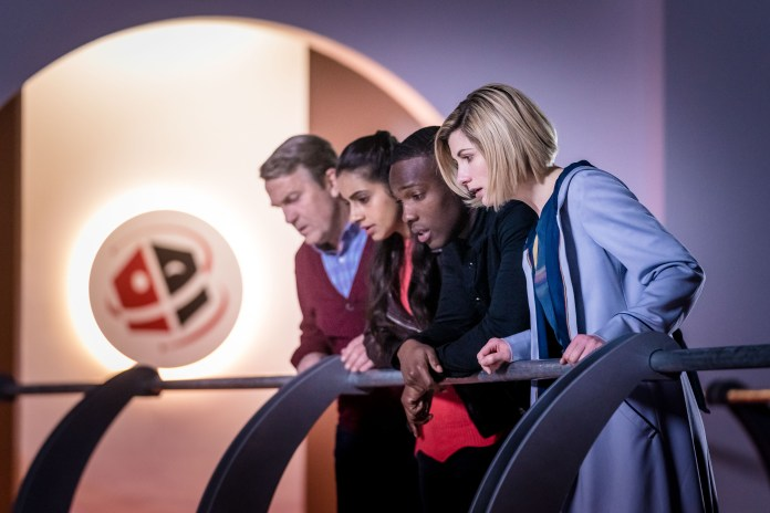 Doctor Who - Series 11 - Episode 7 - Kerblam - Graham (BRADLEY WALSH), Yaz (MANDIP GILL), Ryan (TOSIN COLE), The Doctor (JODIE WHITTAKER) at Kerblam! Headquarters.
