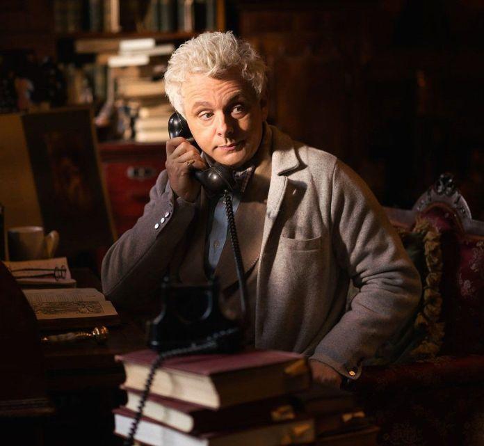 Arizaphale (Michael Sheen) phoning from his bookshop in Good Omens (c) Amazon/BBC Studios AZ Fell