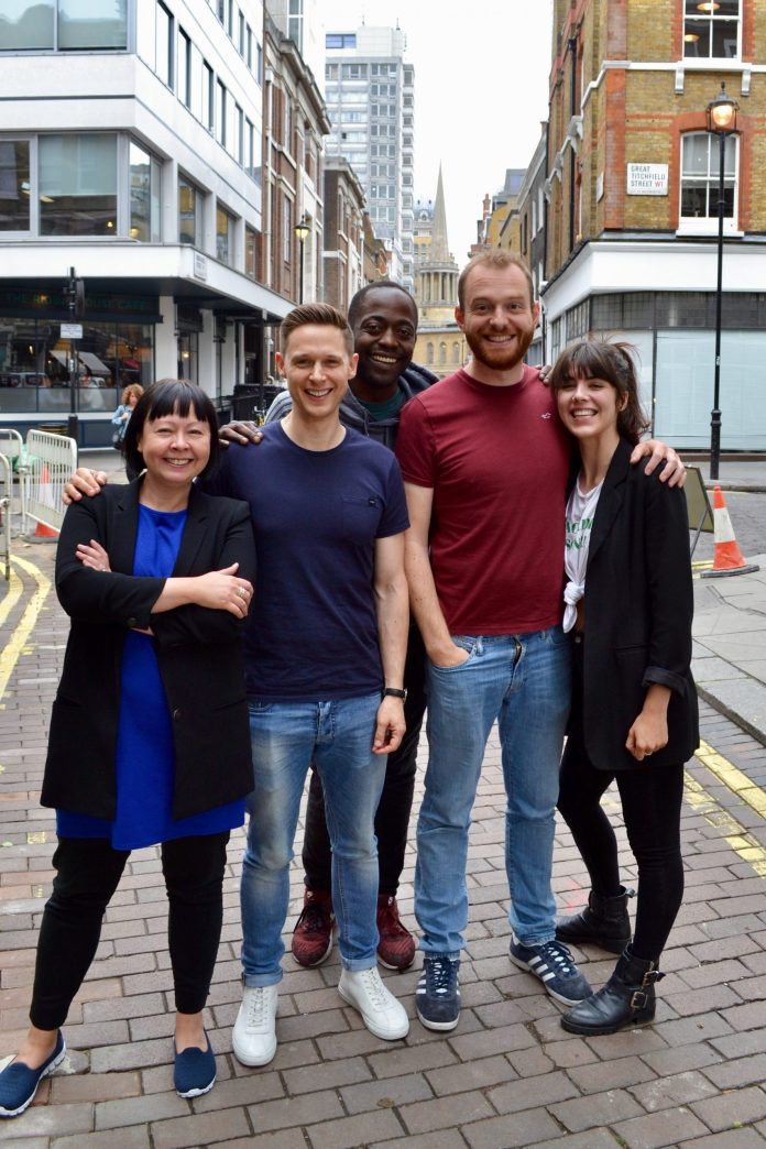 Liz Sutherland-Lim (Landlady), Samuel Barnett (Norton Folgate), Joe Shire (Gideon Lyme), Tom Price (Andy Davidson) and Franchi Webb (Belle Epoch). The stars of Torchwood: Soho take to the streets of Soho! Outside! Together! A photo from the Before Time, surely. (c) Big Finish Productions