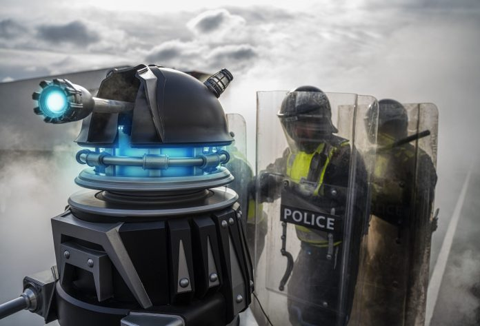 One of the new 'defence drones' leads riot police into action - (C) BBC - Photographer: James Pardon Doctor Who Revolution of the Daleks Dalek