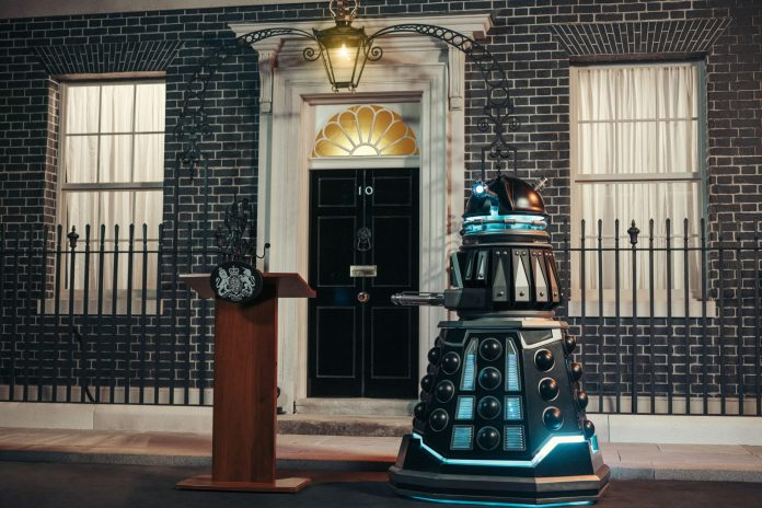 A Dalek stand on alert outside No. 10 in Revolution of the Daleks - (C) BBC - Photographer: James Pardon Doctor Who Downing Street Dalek