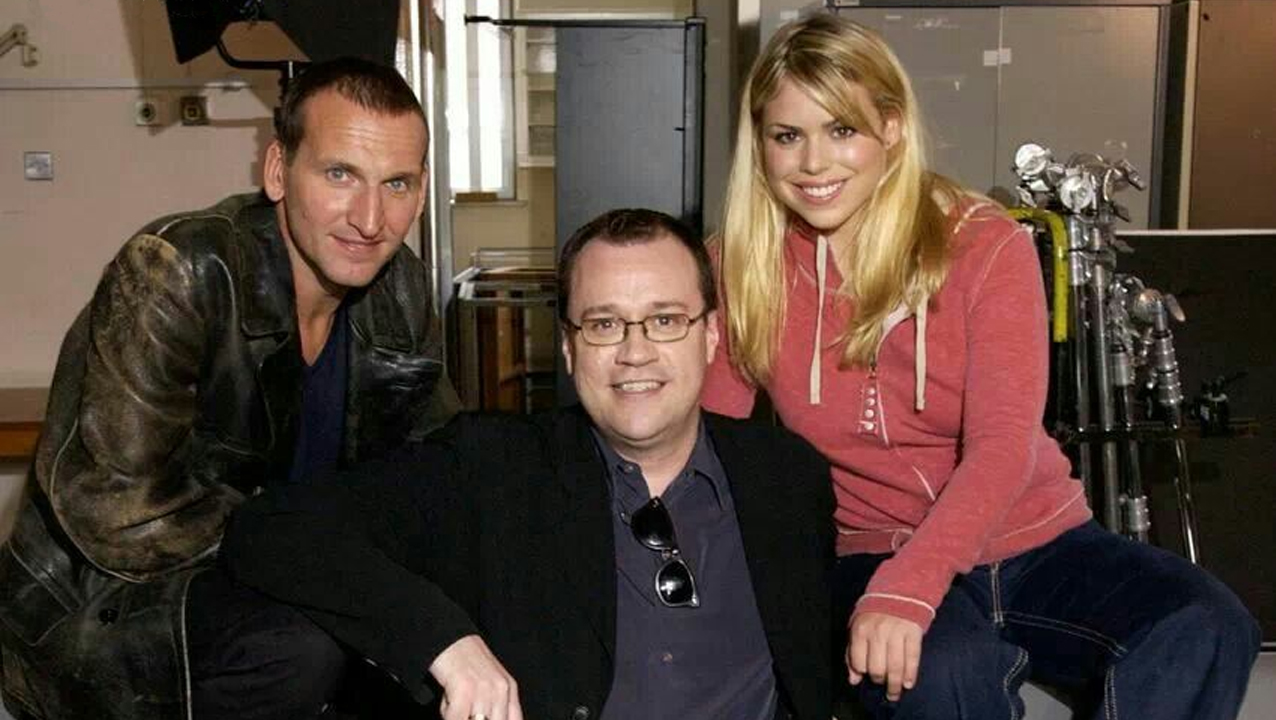 Russell T Davies, with his stars Christopher Eccleston (The Doctor) and Billie Piper (Rose Tyler) in 2004 on the first day of filming of the Doctor Who revival (c) BBC Studios Ninth Doctor RTD Aliens of London