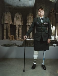 Veteran, Congressionalcandidate, double-amputee Tammy Duckworth standing on artificial legs with aid of cane