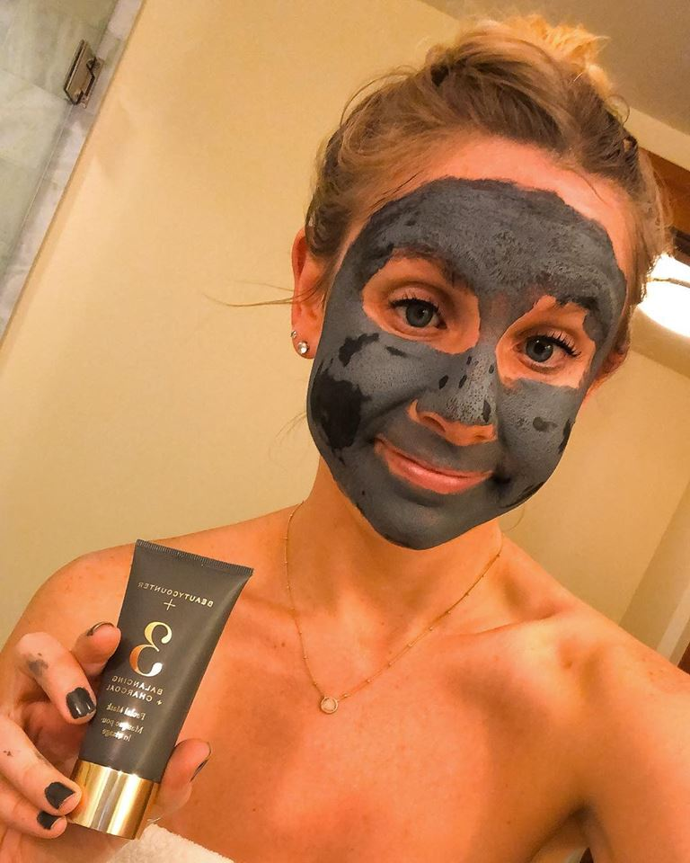 Girl with a charcoal clay mask