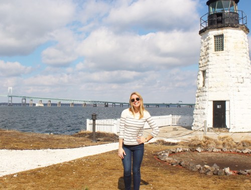 A girl standing in front of a lighthouse in Newport, RI