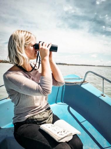 girl boat birdwatching morocco
