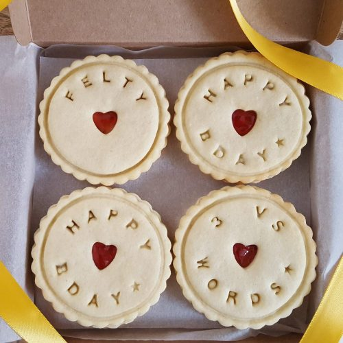 A box of personalised happy birthday biscuits