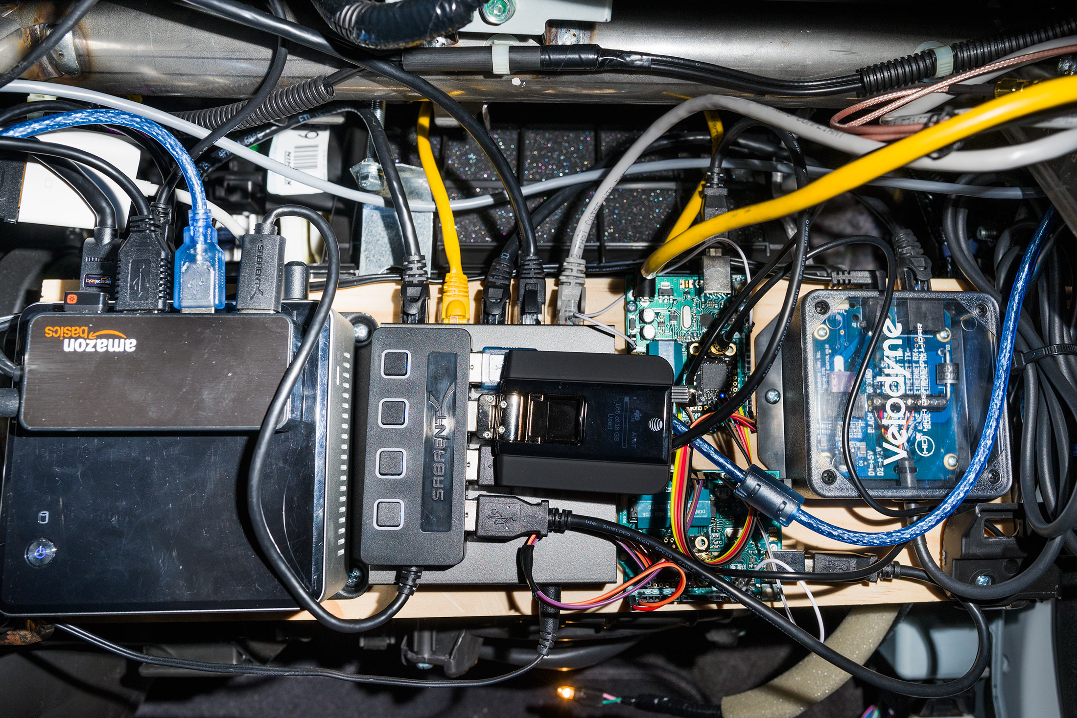 The electronics in George Hotz's glove compartment