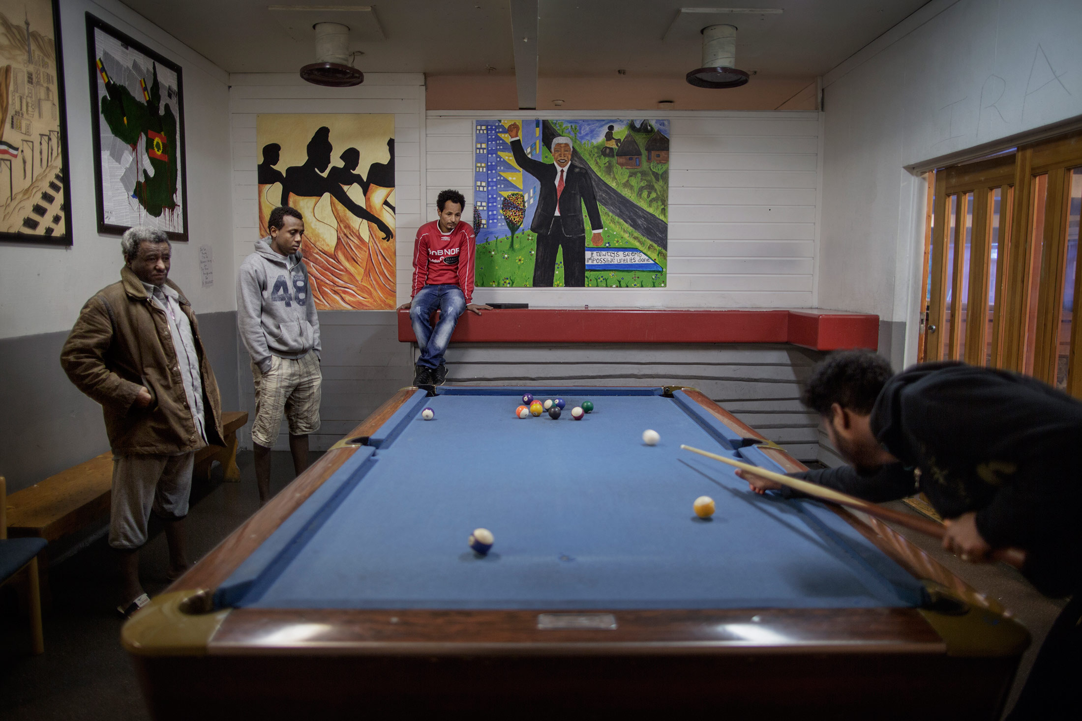 Asylum seekers play billiards at the Hero reception center in Valdres.